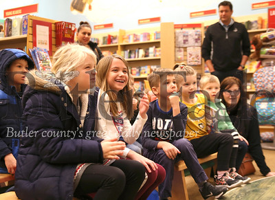 Taylor Natali (left), Nora and Micah Mountain and other Cranberry area kids react to author Gene Natali's children's book reading at Barnes and Noble Saturday. The event, part of Barnes and Noble's StoryTime (one word) gave parents a chance to focus on shopping while entertaining the kids. Seb Foltz/Butler Eagle