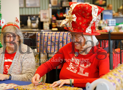 North Hills Stars volunteer Sharon Kopp wraps a present at the gift wrapping station at Barnes and Noble in Cranberry Saturday with Mary Haley. The store hosts nonprofit organizations through the holidays to raise money while wrapping gifts. Seb Foltz/Butler Eagle