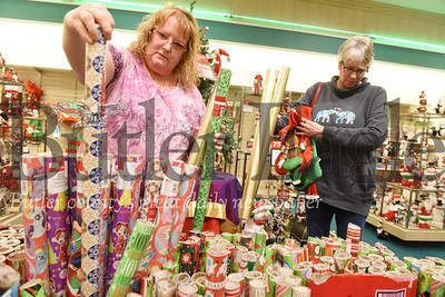 Harold Aughton/Butler Eagle: Friends, Sandi Campbell of Chicora, left, and Lisa Umbaugh spent time together shopping at Boscovs looking for bargins Thursday, December 26, 2019.