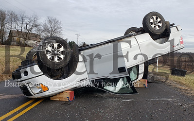 Two vehicles collided on Brownsdale Road Thursday afternoon, sending this pickup truck into the air and onto its roof. No one was injured. Tanner Cole/Butler Eagle