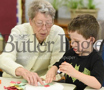Harold Aughton/Butler Eagle: Participants of the intergenerational program, Betsy (left) and four-year-old Nathaniel work on a crafting project at Lifesteps Wednesday, August 28.