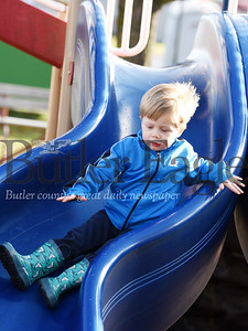 Harold Aughton/Butler Eagle: Lindsey Chappel of Harmony took advantage of the mild temperatures and  took her son Aaron, 2, to the slides at the Zelienople Community Park, Monday, December 30, 2019.