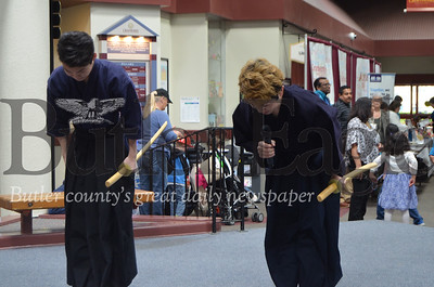 Photo by Alexandria Mansfield. CUTLINE: Masa Mandai (left) and Sunao Matsumoto (right) demonstrate proper bowing after showing the Japanese technique of Kendo on Saturday at the Town Square in the Cranberry Township Municipal Center.