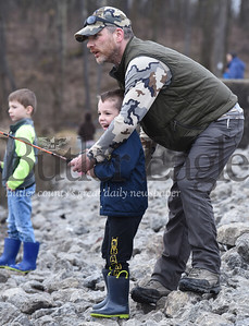 "Five-year-old, Jack Raybuck of Mars attempts to real in his first fish with a little help from his father, Curtis, while his brother, Owen, watches at Glade Run Lake.  Saturday, April 6, was the first day of the Mentored Youth Trout Day allowing children 12 and under to catch two trout each. See extended cultine below   With the Sun tucked behind the clouds, Curtis Raybuck of Mars trekked across the shore line of Glade Run Lake with his three children, Owen, 7; Jack, 5; and 18-month-old Ava in tow. The family had been up since 4:30 a.m. in preparation of the first day of the Mentored Youth Trout Day. They made their way to the breast of the dam near the spillway.  Curtis baited the poles while Ava sat patiently in a little red wagon as the boys frolicked nearby. He checked the time on his cell phone: ""8:09"" he exclaimed and positioned Owen and Jack along the shore line. Helping his sons cast their lines into the lake, he encouraged them to be patient and watch their bobbers carefully. Both Owen and Jack had fish on their line but failed to bring them a shore. However, on his second attempt, Jack found success, catching his first rainbow trout.  ""This is the best day for youth fishing,"" said Curtis Raybuck. ""It's not as fun with the adult anglers... this is perfect!"""