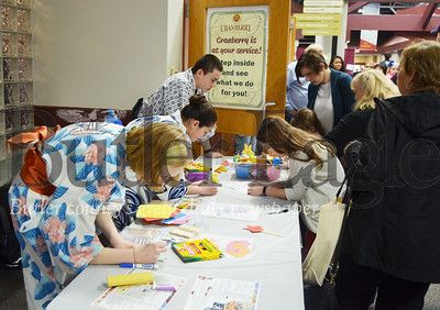 Photo by Alexandria Mansfield. CUTLINE: Emily Tekelenburg (left), Sonya Dietz (center) and Max Skeen (right) show and explain Japanese culture and origami Saturday at CranFest in the Cranberry Township Municipal Center.