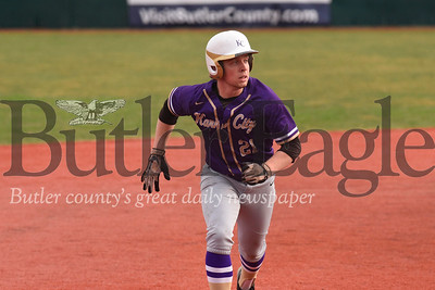 Karns City V Clarion: #21 (shortstop/pitcher) eyes the ball on his way to third base. player had a double play and closed the game pitching