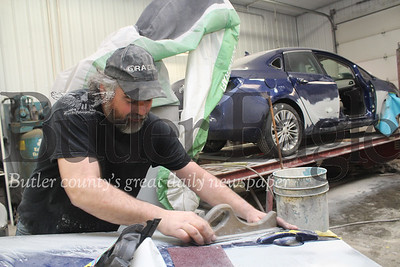 Harold Aughton/Butler Eagle: Mike Miller, master technician, at Baglier Collision Center, preps  a car for painting.