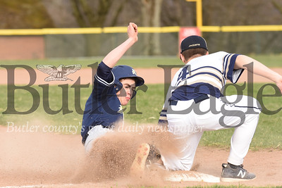 Freeport's Bradyn Clark tags out a Knoch baserunner.