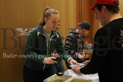 Slippery Rock sophmore Martha Dunkelberger, 19, serves up senior Jake Cribbs, 21, at Friday's Empty Bowls benefit.