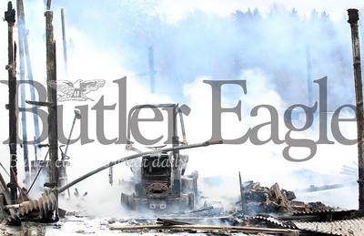 Harold Aughton/Butler Eagle: Barn fire at 455 West Sunbury Road, Monday, April 15.