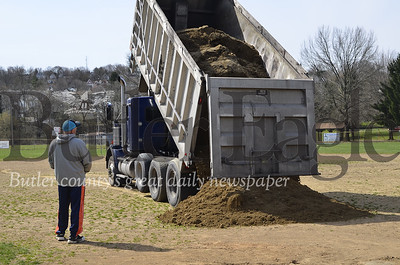 "Jeff Shondelmyer, a softball player from Saltsburg who helps perform maintenance at several softball fields, supervises the unloading of new soil for the field at Father Marinaro Park. He likes the mix applied at the field for its ability to repel water. ""With this stuff, if it rains you just wait a couple of hours to play,"" Shondelmyer said."