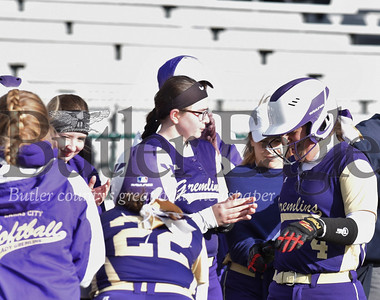 Karns Citys Kate Allen(#4) celebrates with teammates after her homerunover Moniteau.