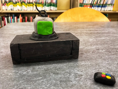 "Pictured is a television, remote and stand that a student made out of clay in the ""Directress: Stop Motion Animation for Girls"" program at the Butler Area Public Library. The films will be screened at the library's Stop Motion Film Festival on Tuesday. Photo by Gabriella Canales."
