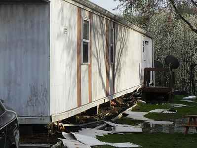 Firefighters responded Thursday afternoon to a fire that caught underneath a trailer at the Saxony Estates. Photo by Nathan Bottiger