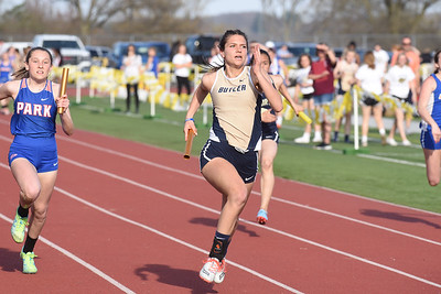 Butler's Gabby Boden pushes toward the finish in the 4x100 relay Thursday at the Butler Invitational. The Golden Tornado ladies finished second in the event. Seb Foltz/Butler Eagle