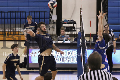 Butler's Sam Lambermont reaches for a spike in Monday's loss to Hempfield. Seb Foltz/Butler Eagle