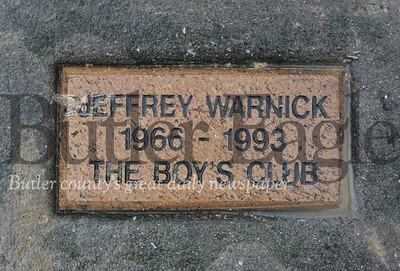 Harold Aughton/Butler Eagle: This plaque sits the base of the tree planted in honor of Jeffrey Warnick's contributions to The Boys Club.