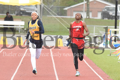 Mars Tai Johnson pushes through the rain on her way to a second place finish in the girls 400 meter. Seb Foltz/Butler Eagle