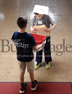 Harold Aughton/Butler Eagle: Connor McGee, 8, a 3rd grader (gray shirt) and Sam Elston, a 6th grader at Penn Christian Academy, volunteered to collect tests at the Math Olympics, Friday, April 12.