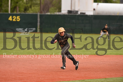 Butler's Cooper Baxter (23) eyes the ball on his way to third base in Monday's loss to North Allegheny.