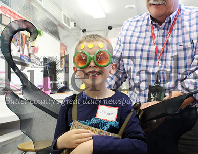 Harold Aughton/Butler Eagle: Agriculture Lab Teacher, Mark Kline, transforms Isaac Wise, 6, a kindergartner at Portersville Christian School into an insect during a hands-on learning activity in the Pennsylvania Farm Bureau's Mobile Agriculture Education Science Lab.