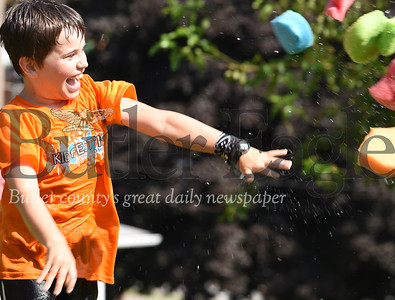 Harold Aughton/Butler Eagle: Isaac Raak, 9, of Butler launches a flurry of water-soaked sponges during Orchard Hill's Kidfest Saturday, July 27, 2019.