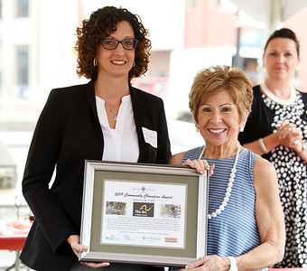 Harold Aughton/Butler Eagle: Tiffanie Rodgers, CFO of ARC and board president, Joanne Meredith, display the 2019 Community Champion Award presented by the Butler County Chamber of Commerce.
