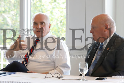 US Rep. Mike Kelly and Rep. Glenn Thompson speak to members of the Community Development Corporation of Butler County and the Butler County Chamber of Commerce as part of a round table discussion Thursday at the Butler Country Club. 08/01/19 Seb Foltz/Butler Eagle