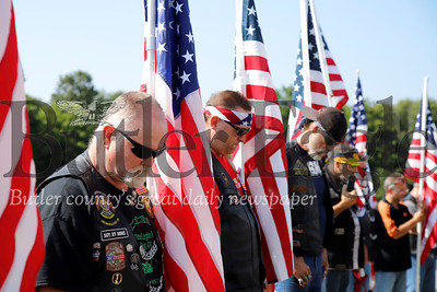 Members of local veterans' motorcycle clubs bow their heads for prayer at Saturday's ceremony awarding Justin Erickson and his wife Jennie their house from Homes for Troops. The couple were brought to their new home with a full escort of multiple motorcycle clubs, police and other officials. Eric lost a leg serving in Iraq. He and his wife, a brain cancer survivor, were awarded the home wheelchair friendly home  from the veteran's charity in recognition of his sacrifices. Seb Foltz/Butler Eagle