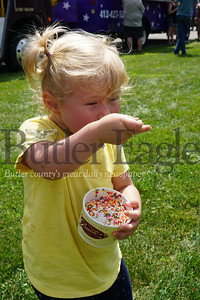 Photo by J.W. Johnson Jr. Esme Birch of Zelienople, who will turn 2 in September, enjoys a dish of ice cream Saturday at the Family Food Truck Festival at Glade Run in Zelienople. In addition to numerous food trucks, the event offered live music, raffles, a car cruise provided by St. Peter's Reformed Church as well as a large model train display by Fort Pitt Hi-Railers. Photo by J.W. Johnson