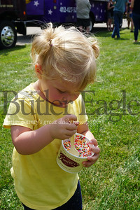 Photo by J.W. Johnson Jr. Esme Birch of Zelienople, who will turn 2 in September, enjoys a dish of ice cream Saturday at the Family Food Truck Festival at Glade Run in Zelienople. In addition to numerous food trucks, the event offered live music, raffles, a car cruise provided by St. Peter's Reformed Church as well as a large model train display by Fort Pitt Hi-Railers.