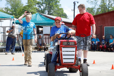 Rylee Sherman, 11, of Cabot pedals his way to a win in his age group in the Pedal Tractor Pull Saturday at the Portersville Steam Show. 08/03/19 Seb Foltz/Butler Eagle