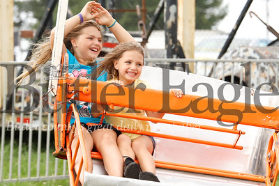 Angelina (left) and Aliyah Hall enjoy one of the spinning rides at the Butler Farm Show Monday. Guests to the Farm Show's opening day were enjoyed short lines and minimal crowds. 08/05/19 Seb Foltz/Butler Eagle