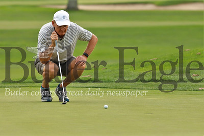 Steve Walczak eyes up his put on hole No. 8 at Butler Country Club Tuesday  Seb Foltz/Butler Eagle