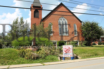 "Photo by Samantha Beal. ""Mars Borough paused plans to secure a $270,000 loan from Mars Bank last night for the purchase of four parcels from the Dutilh United Methodist Church. Council was concerned about a requirement in the loan agreement that some of the property be leased to the Intermediate Unit for five years. Members will be talking to the bank about the stipulation."""