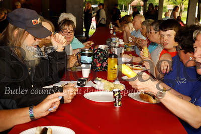 Butler area residents with special needs enjoy hot dogs and corn courtesy of the Rich-Mar Rotary and Butler ARC Wednesday. The rotary ARC bbq and bingo night is held annually at Butler Memorial Park. Seb Foltz/Butler Eagle