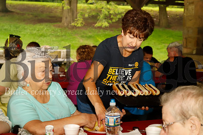 Rich-Mar Rotary volunteer Cindy Fleeson of Cranberry serves up hot dogs at the rotary group's annual ARC Picnic at Butler Memorial Park Wednesday. The bbq and bingo night is for area residents with special needs. Seb Foltz/Butler Eagle