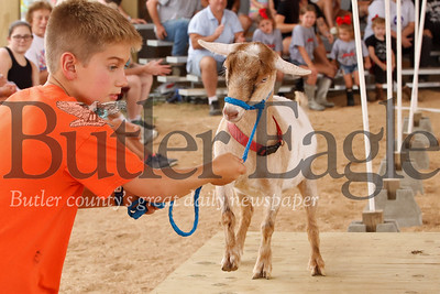 Dylan Thurbe, 9, of Fenelton leads his goat through the Farm Show goat obstacle course Wednesday. Thurber won the 8 to 9 year old division. Seb Foltz/Butler Eagle 08/07/19