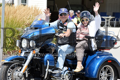 Harold Aughton/Butler Eagle: American Legion Rider, Arthur Terracio, gives 95-year-old, Elma Buttermore, a ride on his Harley Davidson Tri Glide Saturday, August 10.