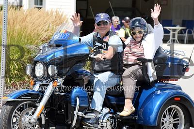 Harold Aughton/Butler Eagle: American Legion Rider, Arthur Terracio, gives 95-year-old, Elma Buttermore, a ride on his Harley Davidson Tri Glide Saturday, August 10.