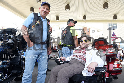 Harold Aughton/Butler Eagle: Arthur Terracio of the American Legion Riders talks with Elma Buttermore, 95, of Lutheran SeniorLife Passavant Community after her motocycle ride, Saturday, August 10.