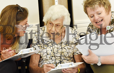 Harold Aughton/Butler Eagle: The judges for the annual Newhaven Court include (left - right) Brandy Jordan, of Grane Hospice, 101-year-old, Madeline Golec, Michele Dolby of Amedisys Hospice. Judges deliberate.