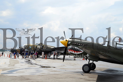 P-40 (right) B-17 (tan colored) B-24 (in background) Seb Foltz/Butler Eagle
