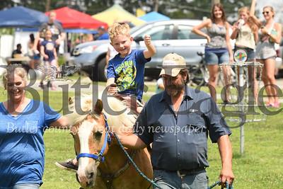 Trenton Hixon,  6, of Renfrew enjoys a free horse ride at Penn Township Community Day courtesy of Paul and Lisa Reichhold of Reichhold Farms. Seb Foltz/Butler Eagle