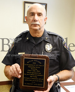 Harold Aughton/Butler Eagle: Butler Township Police Chief John Hays was recently recognized for 40 years of service.