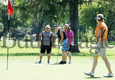 Harold Aughton/Butler Eagle: Dawne Blazevich attempts a putt during the Butler County Chamber of Commerce Ladies Golf Outing while team members Robin Christy, Darla Dibiase and Monica Campagna look on...Monday, August 19, 2019.