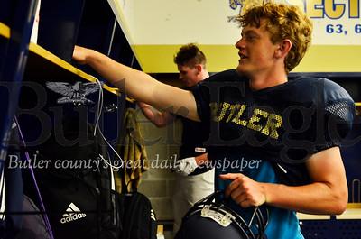 Emerson Douthett, 17, a senior kicker and punter for the Golden Tornado football team uses his new locker. The varsity locker room got new lockers and flooring over the summer. Tanner Cole/Butler Eagle