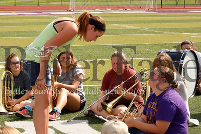Karns City marching band director Amanda Pivirotto looks at music between songs at band practice Tuesday. Seb Foltz/Butler Eagle 082019