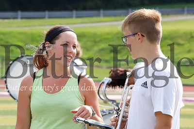 Karns City marching band director Amanda Pivirotto chats with one of her band members between songs at practice Tuesday at Karns City High School. Seb Foltz/Butler Eagle 082019