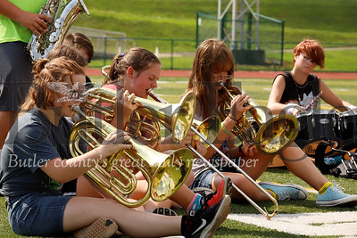 Karns City marching band members try to beat the heat Tuesday, taking a break from marching to practice will sitting on the turf at Karns City High School. Seb Foltz/Butler Eagle 082019